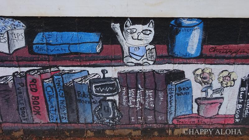 壁に描かれたまねき猫